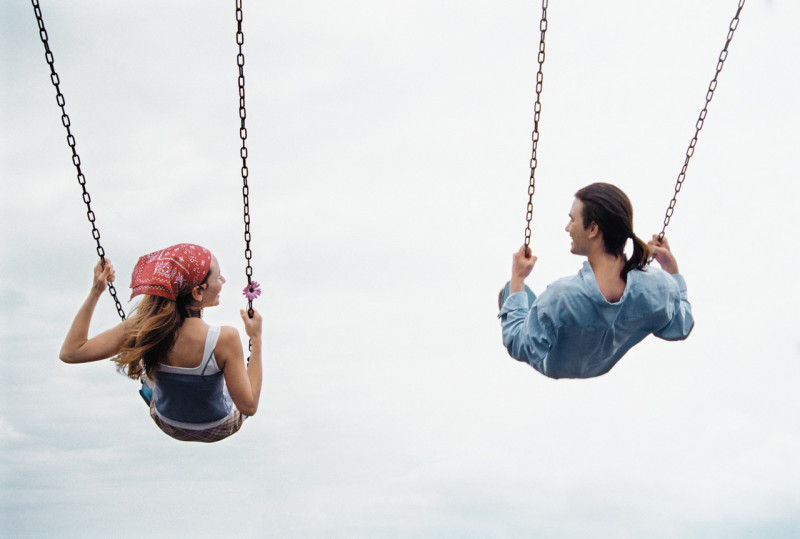 Couple Playing on a Swing